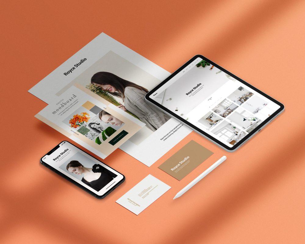 Marknadsföringsmaterial, urklipp från hemsida, visitkort, reklamfolder i olika former liggandes på orangefärgad bakgrund